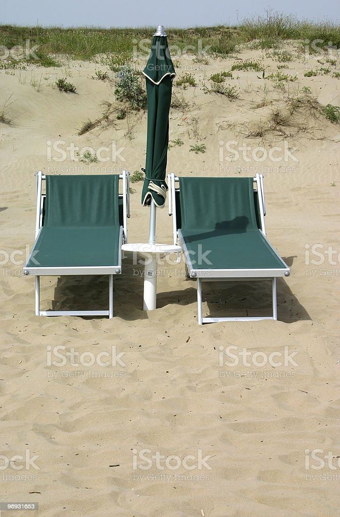 Abandoned beach chairs royalty-free stock photo