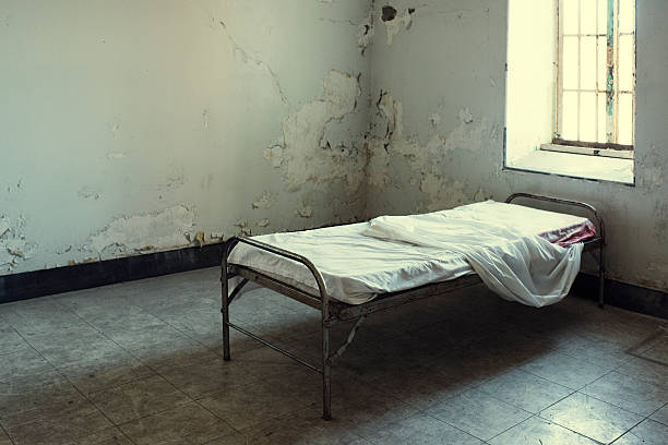 Abandoned Bed in Mental Hospital stock photo