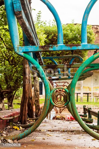 These old square benches look nostalgic after the rain, they are rusty but beautiful