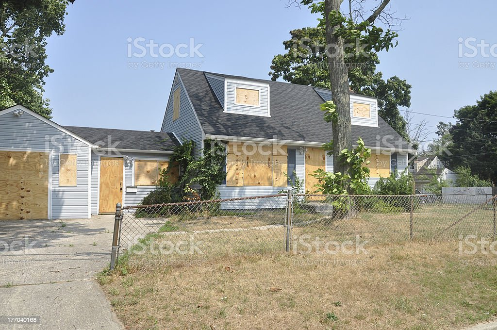 Abandoned Boarded Cape Cod Style Home stock photo