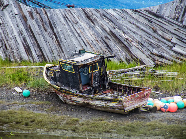 abandoned boat on dry land old wooden boat abandoned on dry land in Alaska alas stock pictures, royalty-free photos & images
