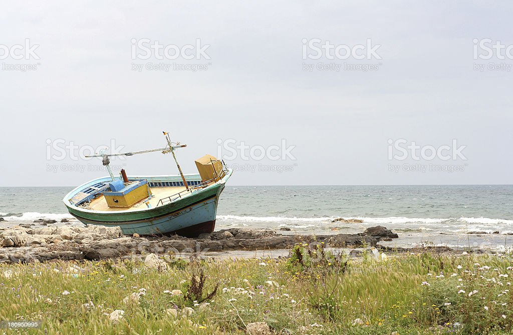 Abandoned boat on the beach stock photo