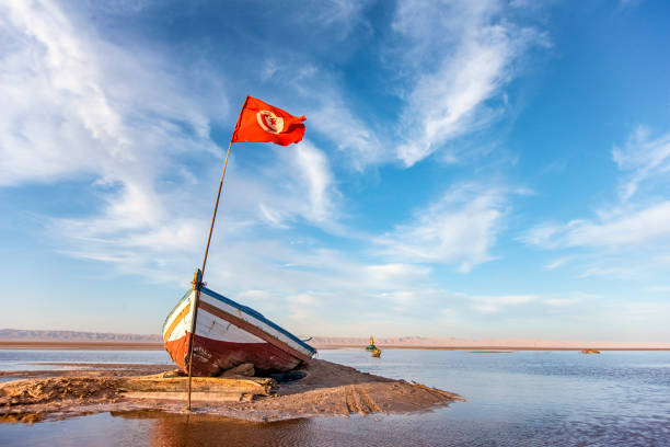 abandoned boat on the bottom of dry salty lake stock photo