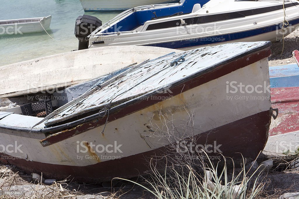 abandoned boats on tropical beach decay royalty-free stock photo