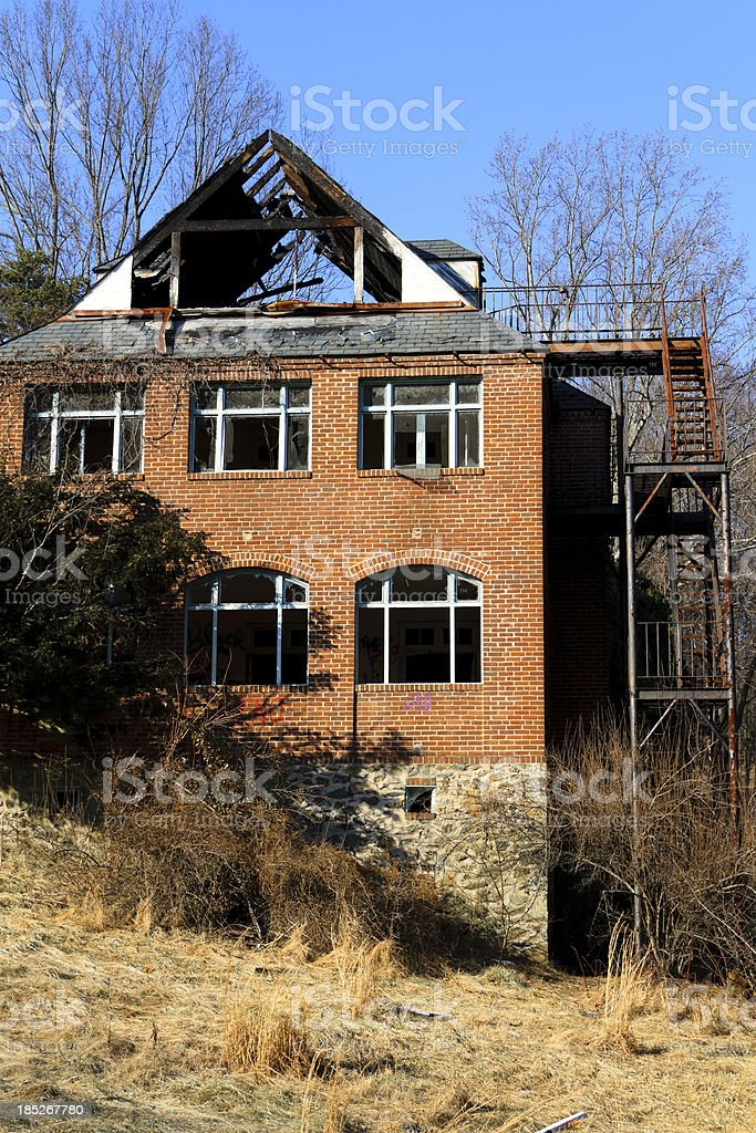 Abandoned Brick Building With Burned Out Roof stock photo