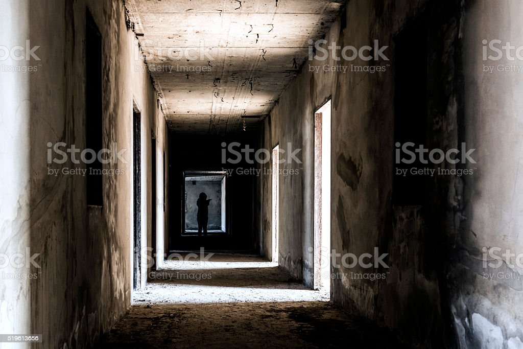 Abandoned building ghost living place with scary woman inside stock photo