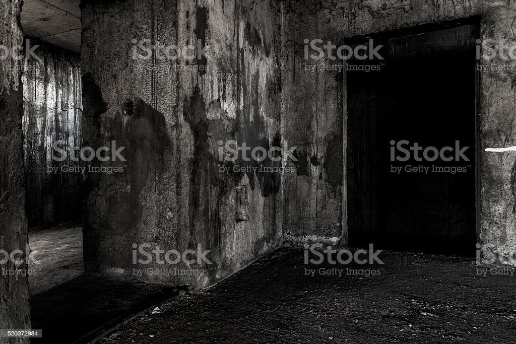 Abandoned building ghost living place with two doors stock photo