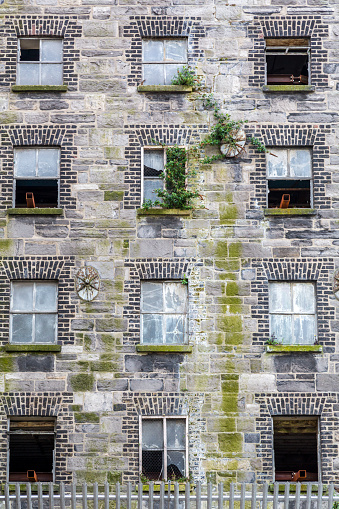 Vertical composition of a building in decay at the center of Dublin Ireland.
