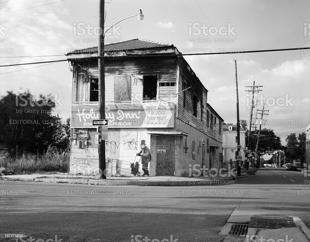 Abandoned Building in New Orleans with Banksy Graffiti stock photo