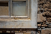 Close up of a window on an abandoned stone-built building
