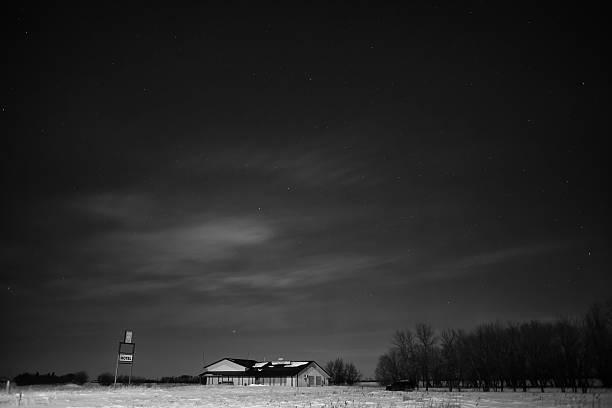 Abandoned building under night sky stock photo
