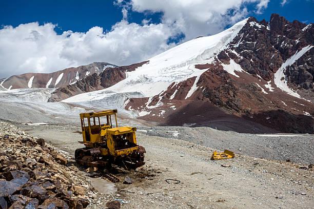 Abandoned bulldozer in mountains. Kyrgyzstan stock photo