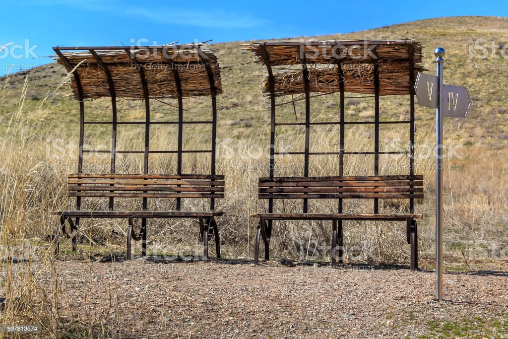 abandoned bus stops and dilapidated places for recreation in the wild steppe stock photo