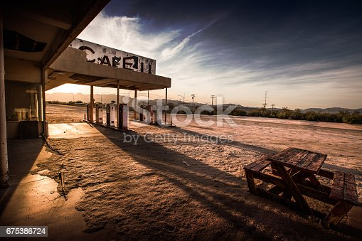 An abandoned cafe/gas station sits in the California desert.