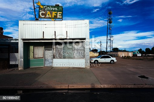 Holbrook, Arizona, United States- July 18, 2013: Abandoned cafe on route 66. The route 66 was one of the original highways within the U.S. Highway System. On June 27, 1985, it has been replaced in its entirety by the Interstate Highway System and many business had to close due to a decrease of customers.