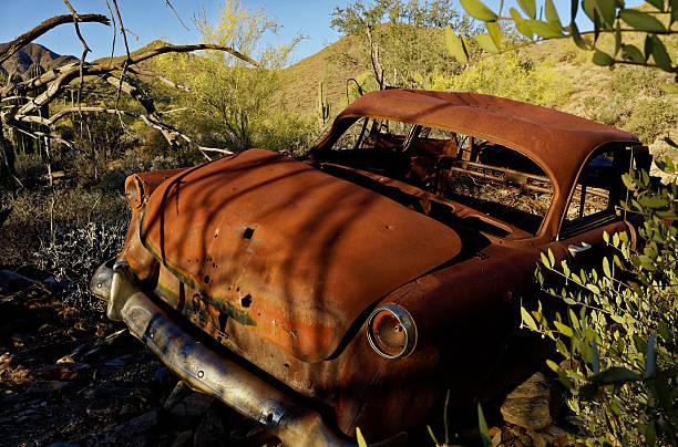 Abandoned car in desert stock photo