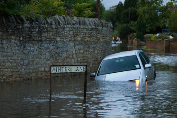 Abandoned Car in rural Flooding stock photo