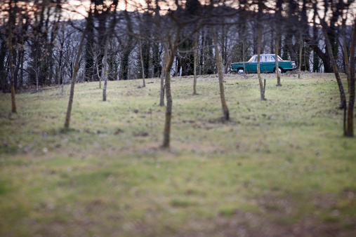 Abandoned Car In Tilt Shift Stock Photo - Download Image Now