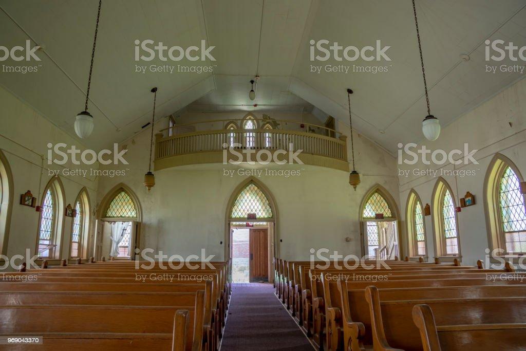 Abandoned church in prison yard stock photo