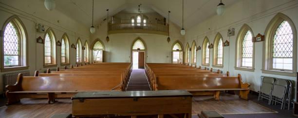 Abandoned church interior prison yard stock photo