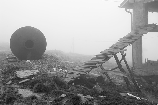 Abandoned villa construction in a mountain resort area during a misty autumn.
