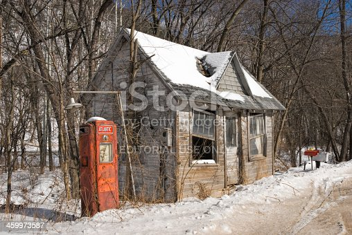 Saxton, Pennsylvania, USA- February 16, 2007: Abandoned and run down American gas station in the country.