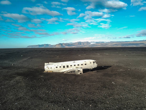 Abandoned DC-3 airplane wreckage on Solheimasandur, Iceland United States Navy Douglas DC-3 plane wreckage (from 1973) on the black beach at Solheimasandur, in the south coast of Iceland. Photo taken with DJI Mavic Pro. sólheimasandur stock pictures, royalty-free photos & images