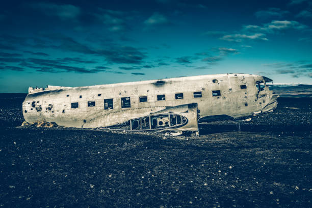 Abandoned DC-3 airplane wreckage on Solheimasandur, Iceland United States Navy Douglas DC-3 plane wreckage (from 1973) on the black beach at Solheimasandur, in the south coast of Iceland. Photo taken by Sony a7R II, 42 Mpix. sólheimasandur stock pictures, royalty-free photos & images