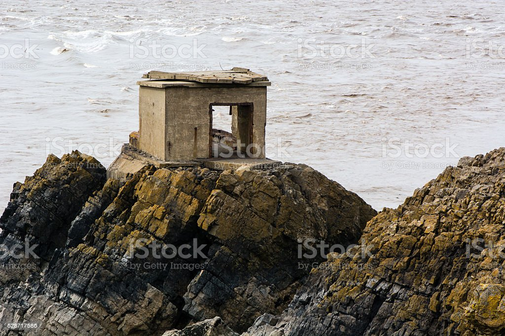 Abandoned defence post on British coast stock photo