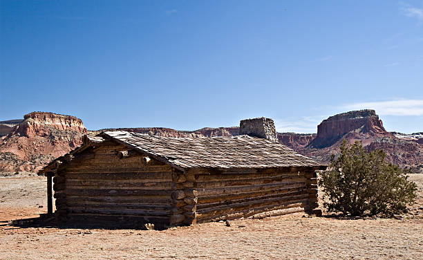 Abandoned Desert Cabin and Rocky Buttes Near Abiquiu, New Mexico stock photo