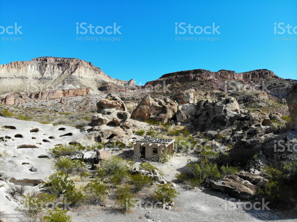 Abandoned desert dwelling in Texas Mountains - Aerial View 1 stock photo
