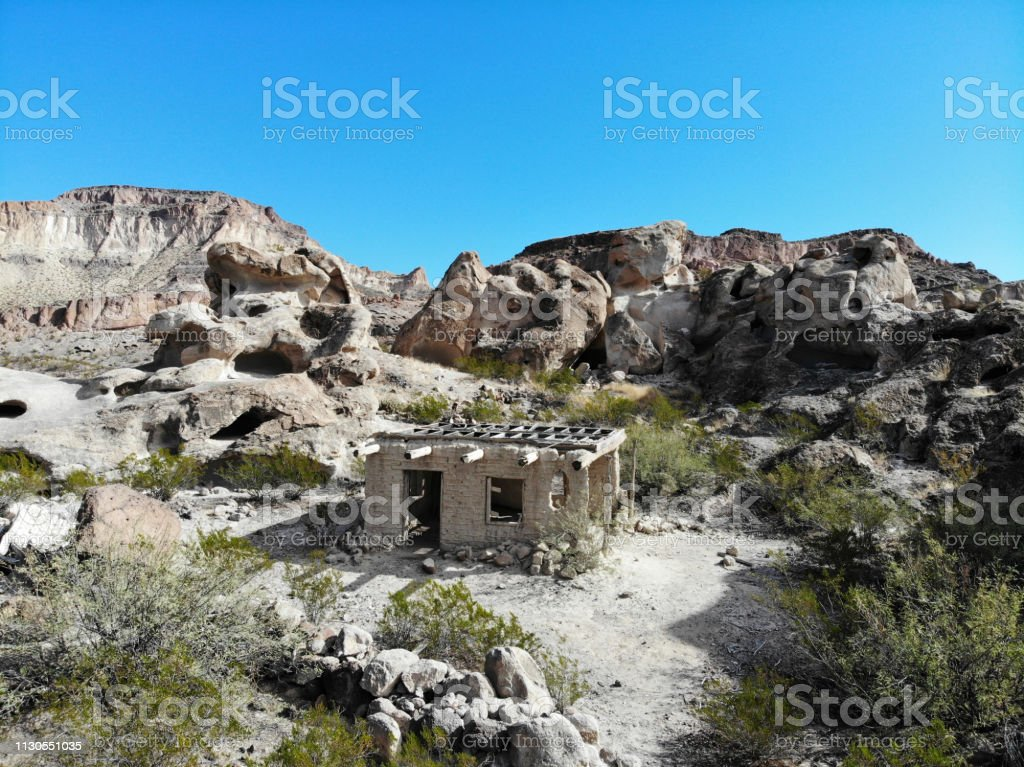 Abandoned desert dwelling in Texas Mountains - Aerial View 2 stock photo