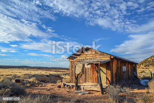 Old shack used to be someone's home. High desert of Navajo County, Arizona. American Southwest.