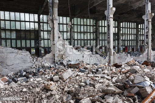 istock Abandoned destroyed factory building, industrial background 486033244