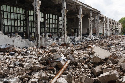 istock Abandoned destroyed factory building, industrial background 486033250