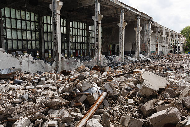 Abandoned destroyed factory building, industrial background stock photo