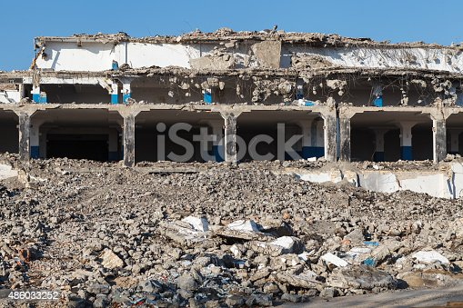 istock Abandoned destroyed factory building, industrial background 486033252