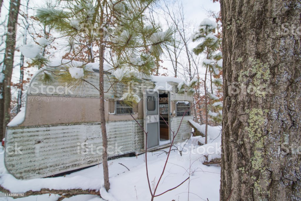 Abandoned Dilapidated Rv With Door Open In The Woods In