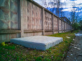 istock Abandoned dirty mattress in industrial territory 950661520