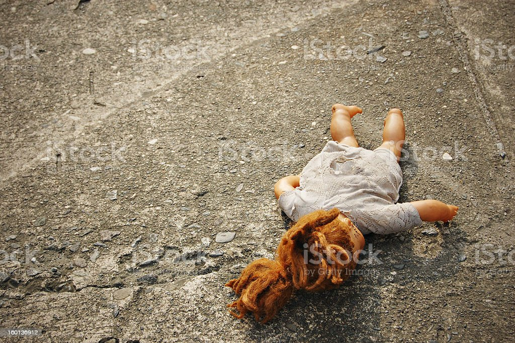 Abandoned Dirty Toy Doll stock photo