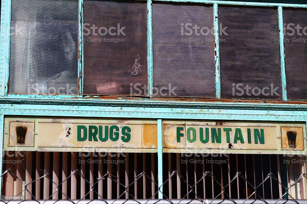 Abandoned drugstore building storefront stock photo