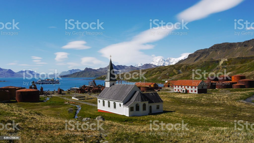 Abandoned early 19th century Norwegian whaling station and settlement, Grytviken, with remains of whale oil processing plant. Whalers Luthern church in center. South Georgia Island. stock photo