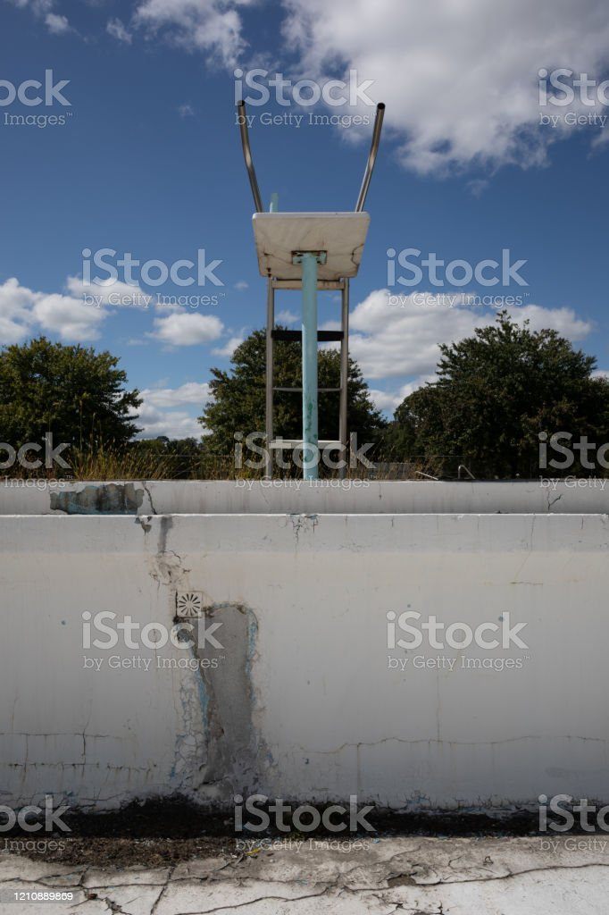 Abandoned Empty Swimming Pool In Decay With White Puffy Clouds In The Sky On A Sunny Day Stock Photo Download Image Now Istock