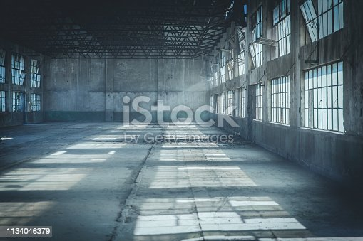 istock Abandoned Factory Building In Tyndall Effect 1134046379
