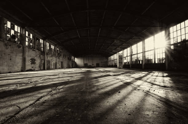 Abandoned factory building Long shadows in abandoned factory building on sunny summer day. derelict stock pictures, royalty-free photos & images