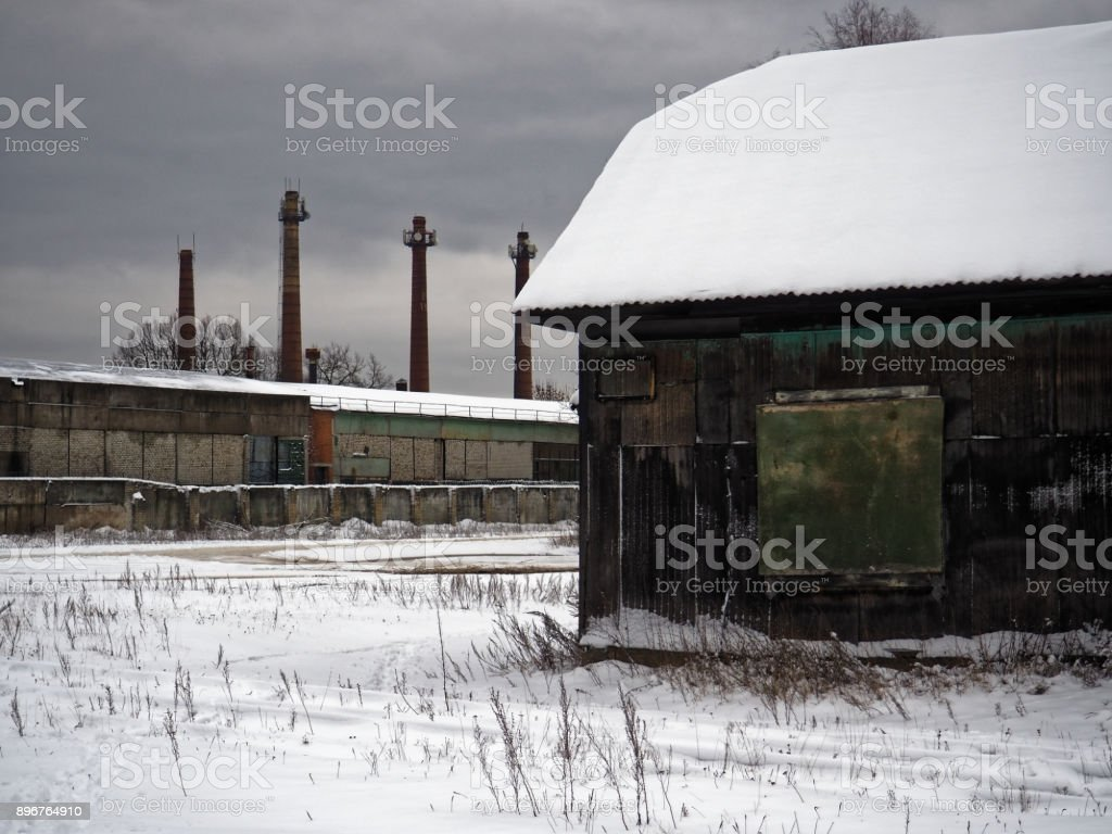 Abandoned factory in winter stock photo