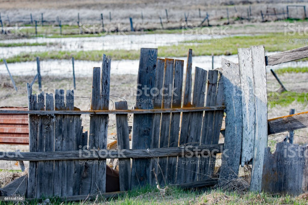 Abandoned farm and homestead with field and fences royalty-free stock photo
