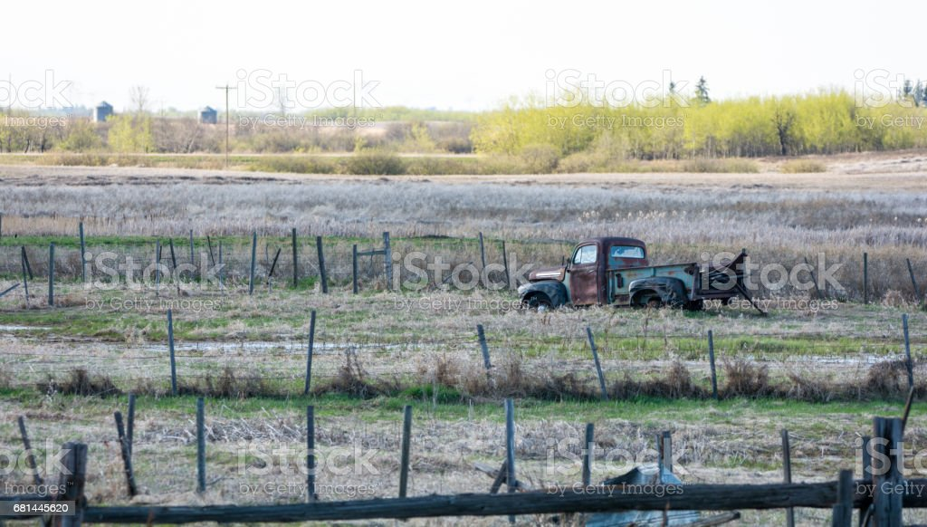 Abandoned farm and homestead with machinery and fences royalty-free stock photo