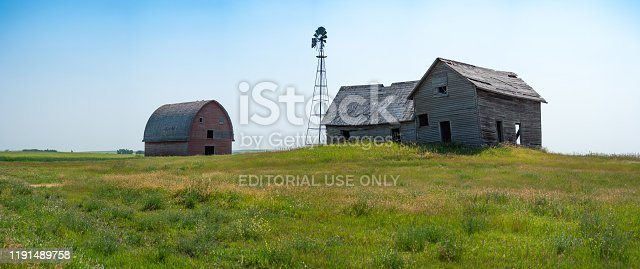 An abandon farm south of Calgary, Alberta in summer. This site has been abandoned for many years but represents the history of Alberta and the legacy of family farming in the area.