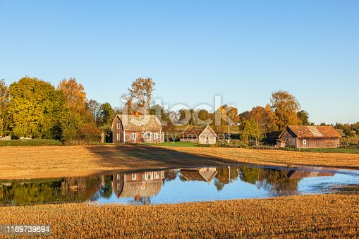 istock Abandoned farm with reflections in the water at the field 1169739894